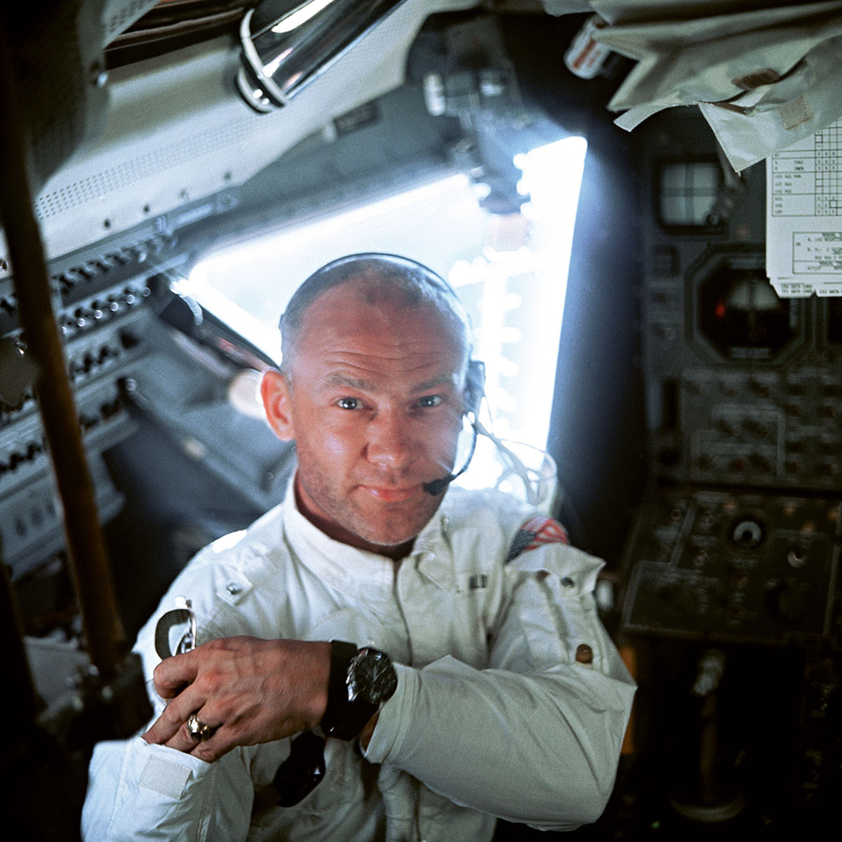 Buzz Aldrin in the cockpit of the Lunar Module, wearing his OMEGA Speedmaster