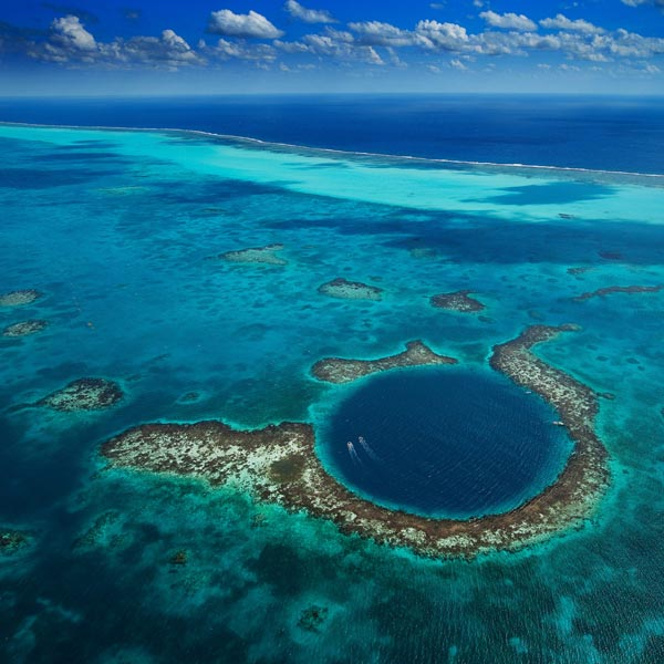A photo of the Great Belize Blue Hole in the Caribbean Sea by Yann Arthus Bertrand