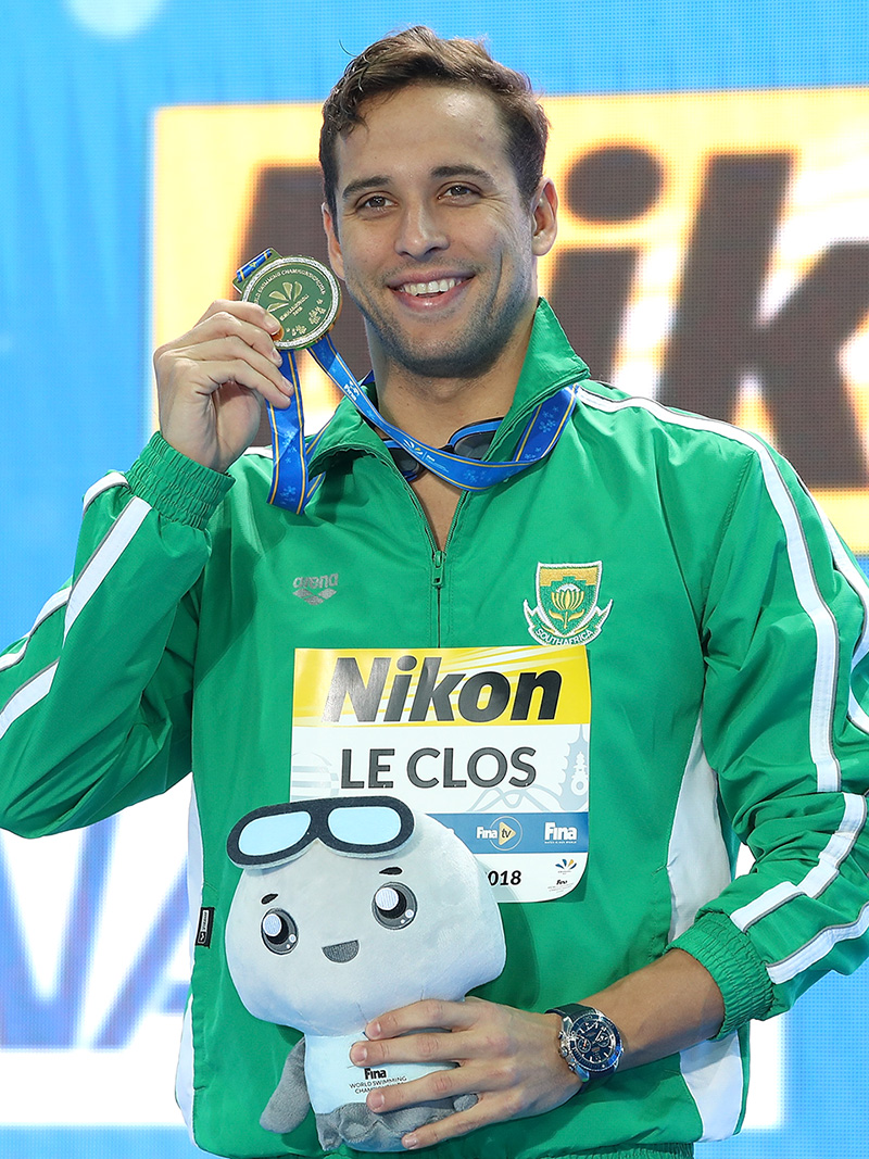 Chad Le Clos with a medal and Omega Watch