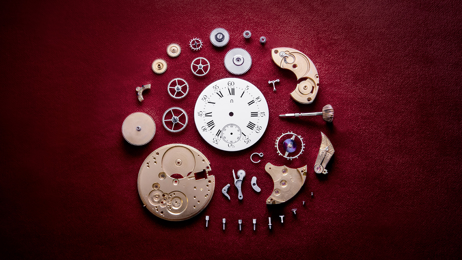 The pieces of the Omega pocket watch mechanism