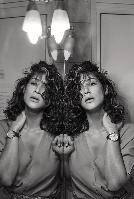 Model wearing a De Ville Trésor watch, reflecting in a mirror