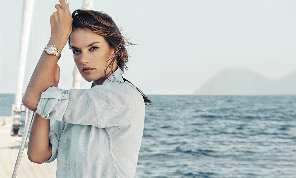 Alessandra Ambrosio on the deck of the sailboat with her OMEGA watch