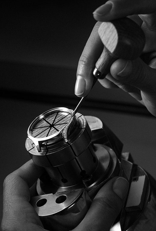 Watchmaker placing diamonds on the side of the Omega Trésor watch