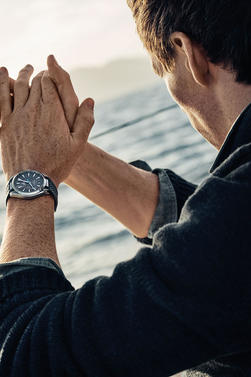 Eddie Redmayne wears an Omega watch on a sailboat