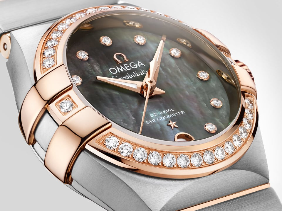 Elegant view of a Constellation watch for ladies with a steel and rose gold case and black mother-of-pearl dial