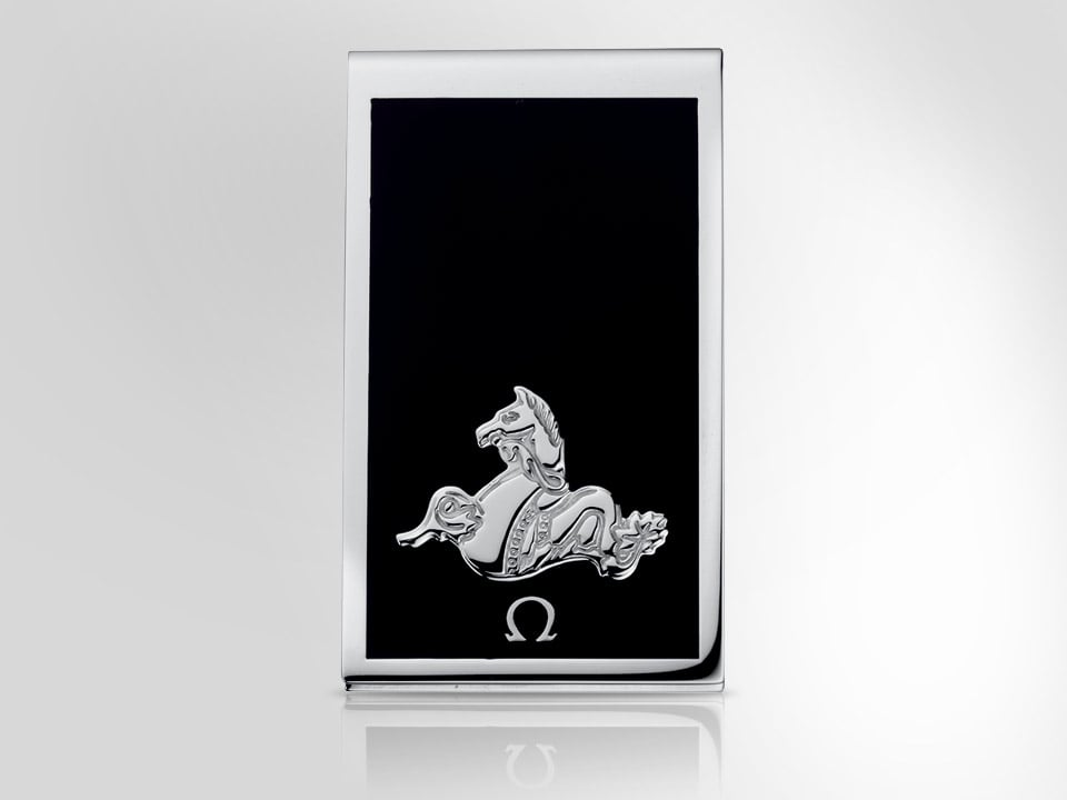 Black money clip engraved with a seahorse and the Omega logo