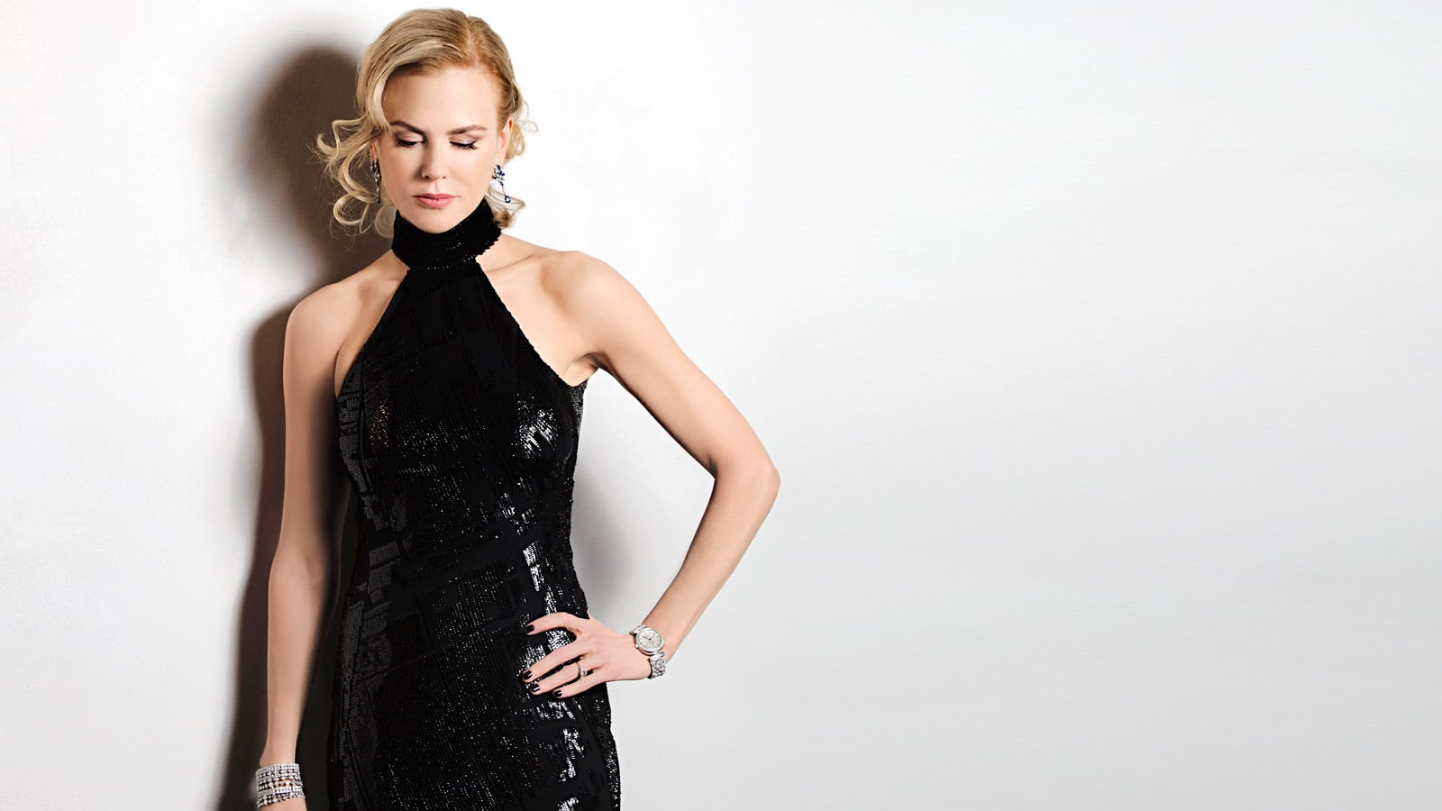 Picture of Nicole Kidman in black dress in front of a grey wall