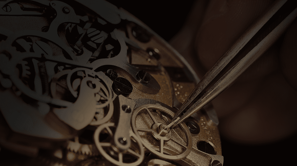 Close-up view of a watch movement being manipulated with tweezers