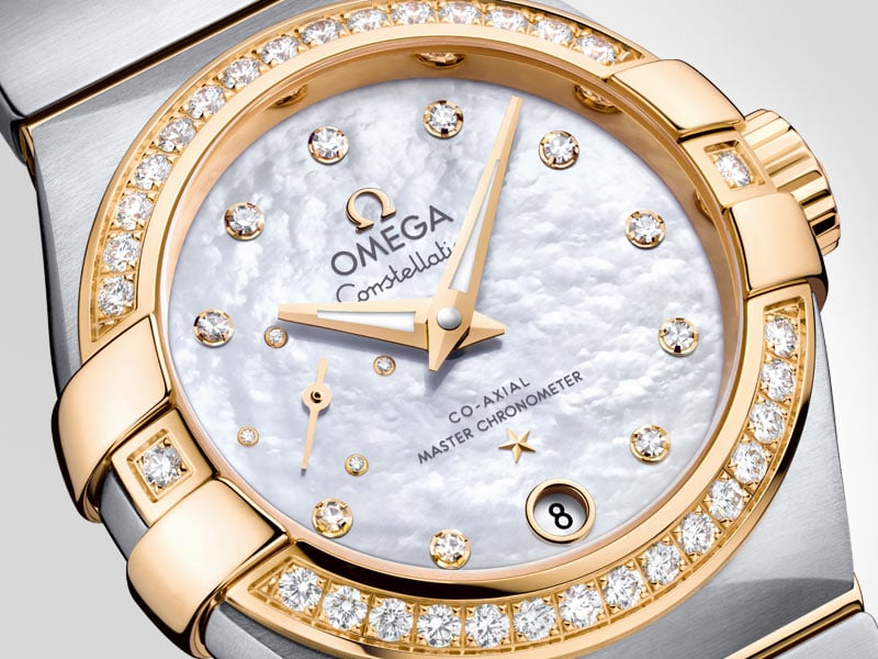 Closeup view of the dial of the Constellation Petite Seconde in yellow gold and steel with diamonds