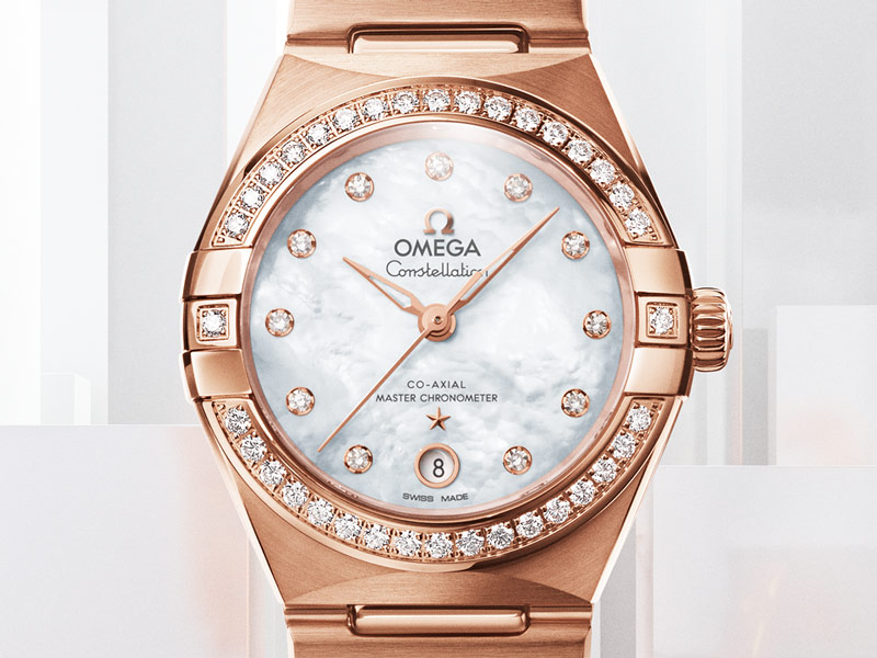 Closeup view of a Constellation watch for ladies with a gold and steel watch case encrusted with diamonds