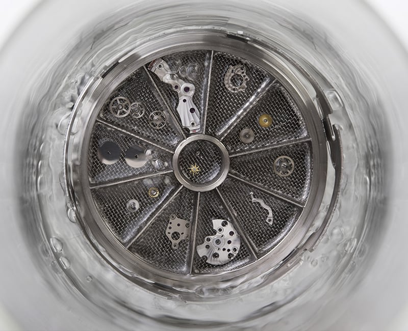 Watch movement cleaned in a ultrasonic bath