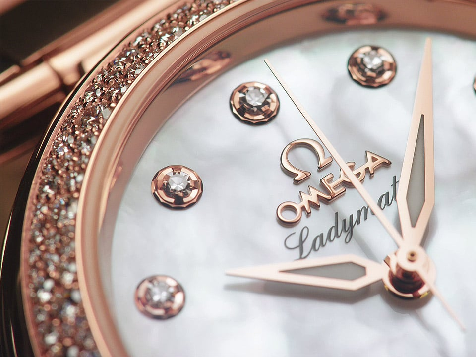 Closeup of the dial and hands of a Ladymatic watch with dimaond indexes and mother-of-pearl dial