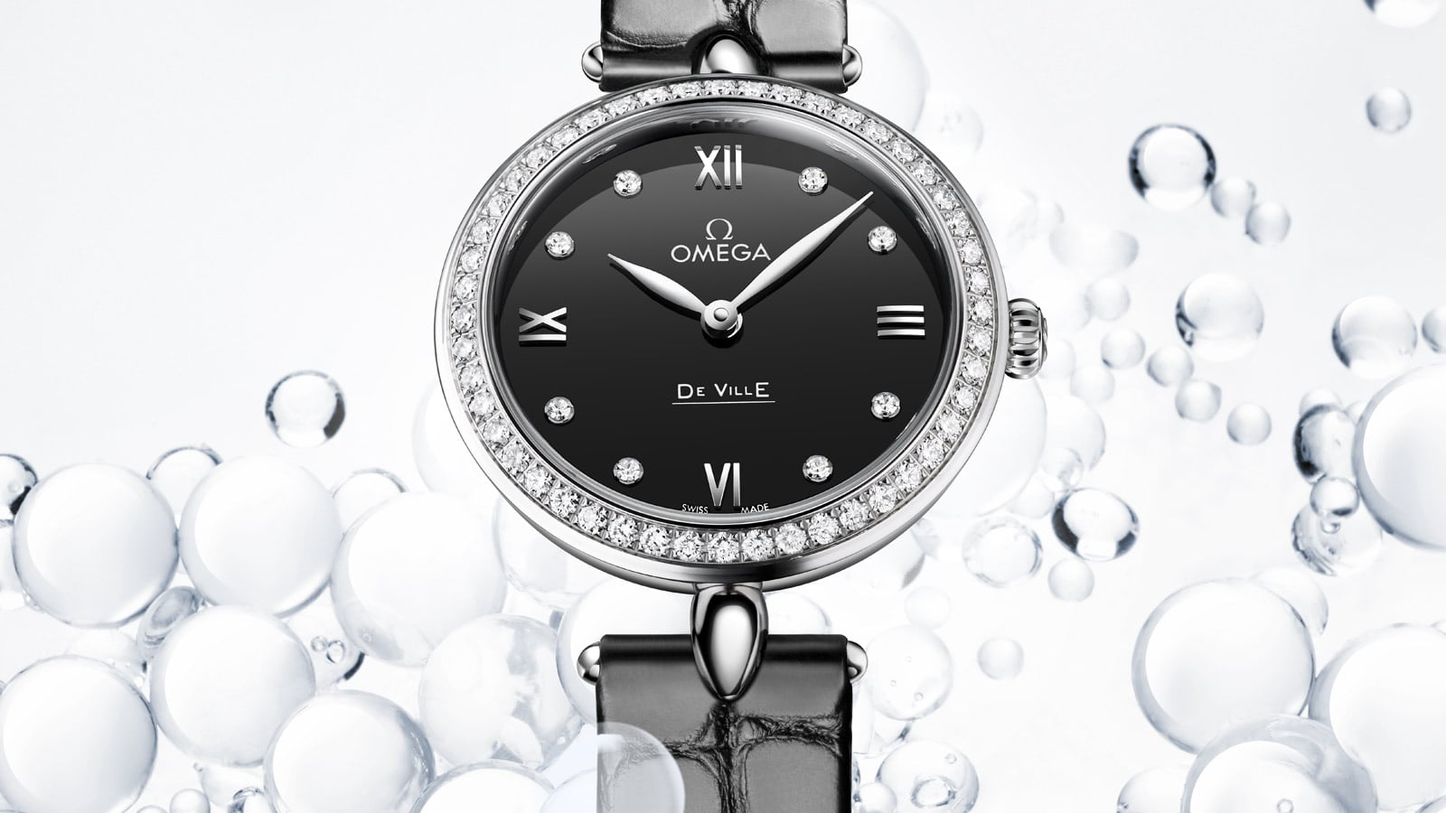 Round De Vile Prestige Dewdrop watch in stainless steel with a black dial