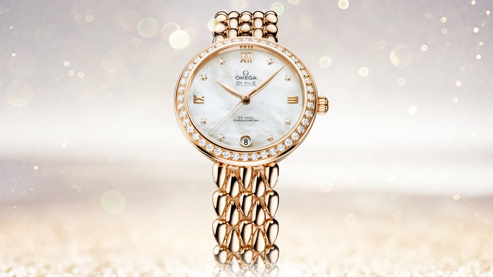 Omega Dewdrop watch in yellow gold with 8 diamond indexes on its mother-of-pearl dial