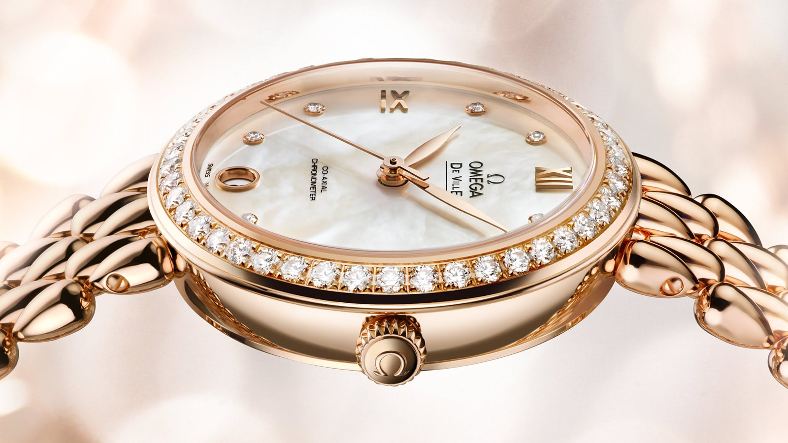 Side view of a Prestige Dewdrop watch with its diamond encrusted case and crown engraved with the Omega logo