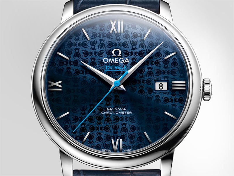 Orbis collection watch with its distinctive blue dial engraved with teddy bears