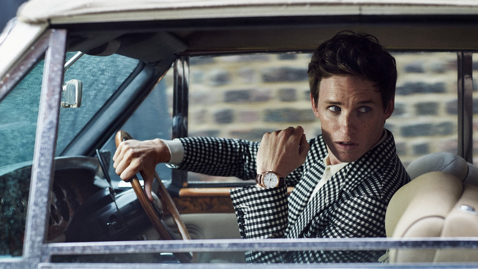 Picture of Eddie Redmayne driving an old-fashioned car