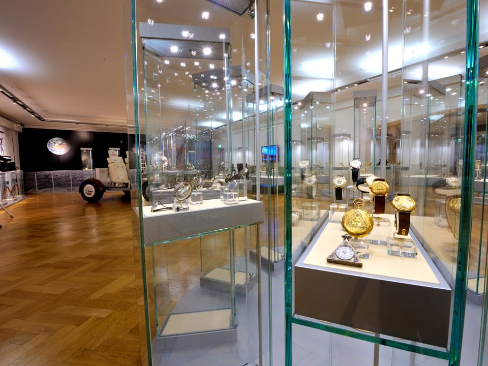 View from the Omega museum interior with watches in showcases in the foreground and a moonrover in the background