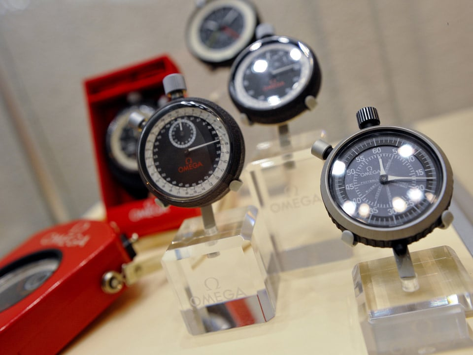 Various Omega chronometers exposed on glass stands