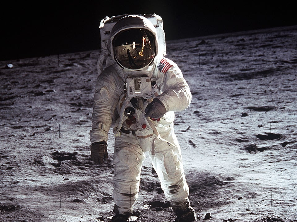 Full shot of an astronaut walking on the moon