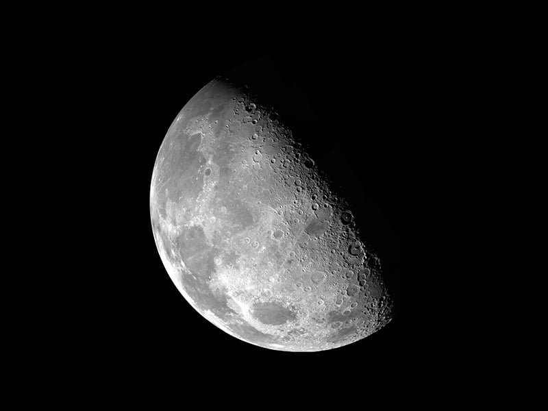 Full picture of a half-illuminated moon