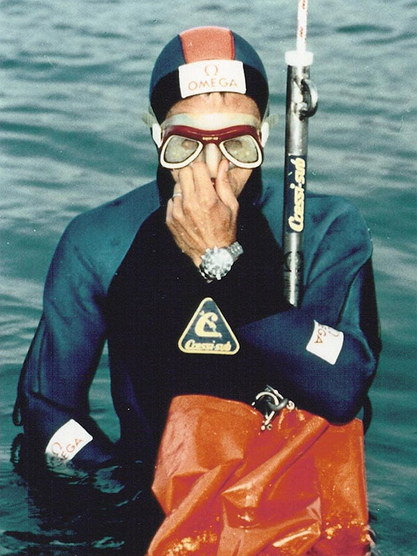 Diver wearing an Omega watch and diving suit, ready to dive