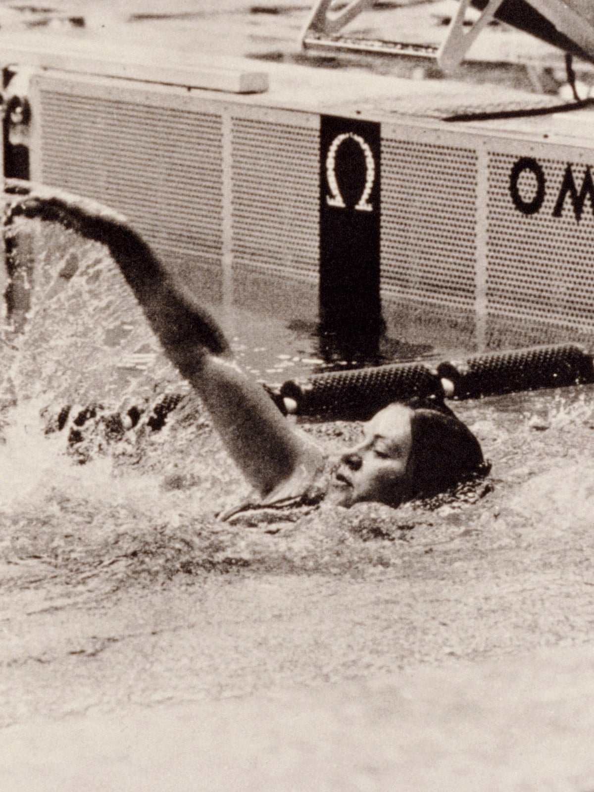 Swimmer in a swimming pool in a black and white photo