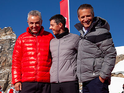 Rory McIlroy and Raynald Aeschlimann on top of the Jungfraujoch