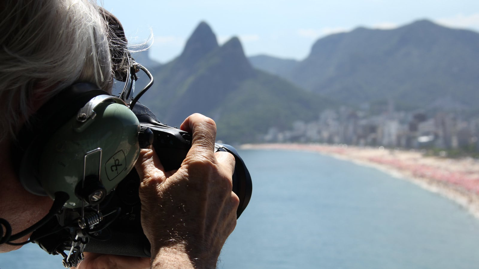 Yann Arthus-Bertrand taking a photo from a helicopter