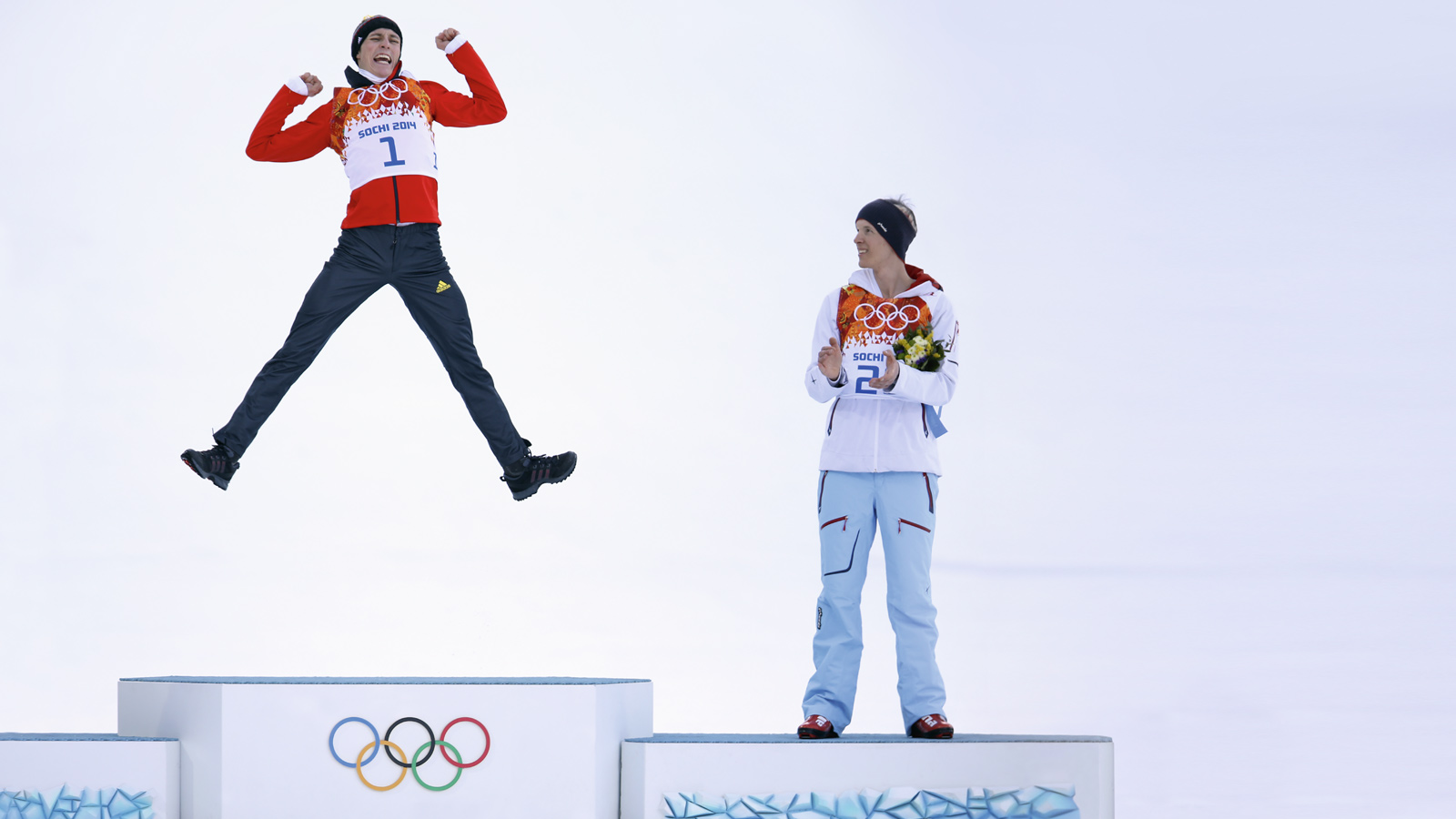 Nordic combined athlete Eric Frenzel jump on the podium next to Lukas KLAPFER during 2014 Sotchi Winter Olympics