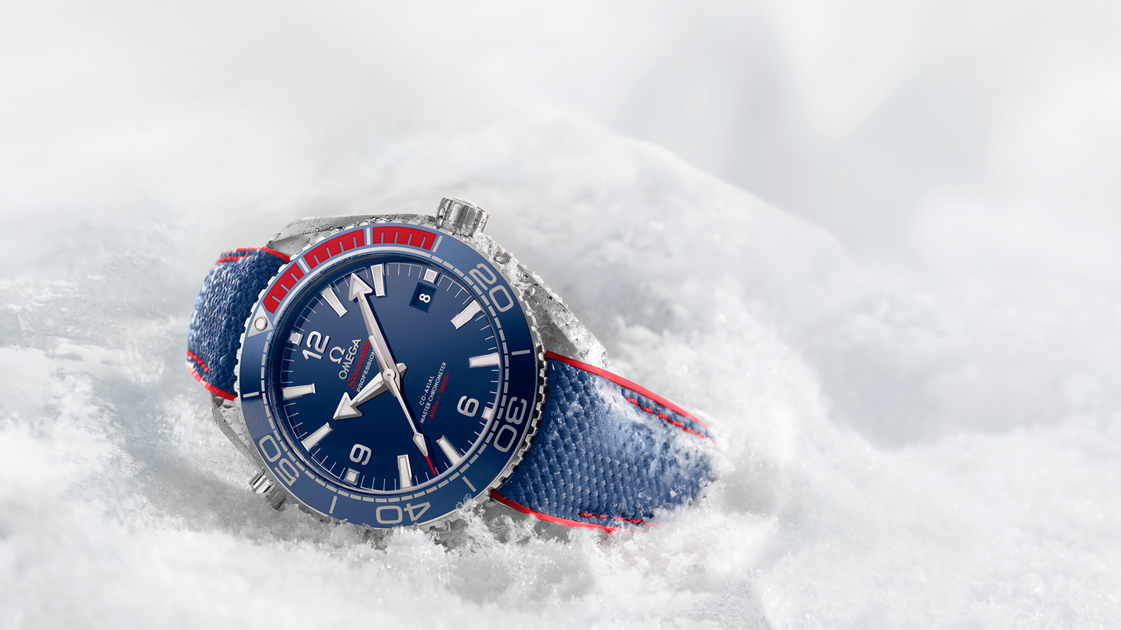 Watch Omega OLYMPIC GAMES COLLECTION Pyeongchang 2018 Limited Edition Red and blue Steel on rubber strap sunk in the snow
