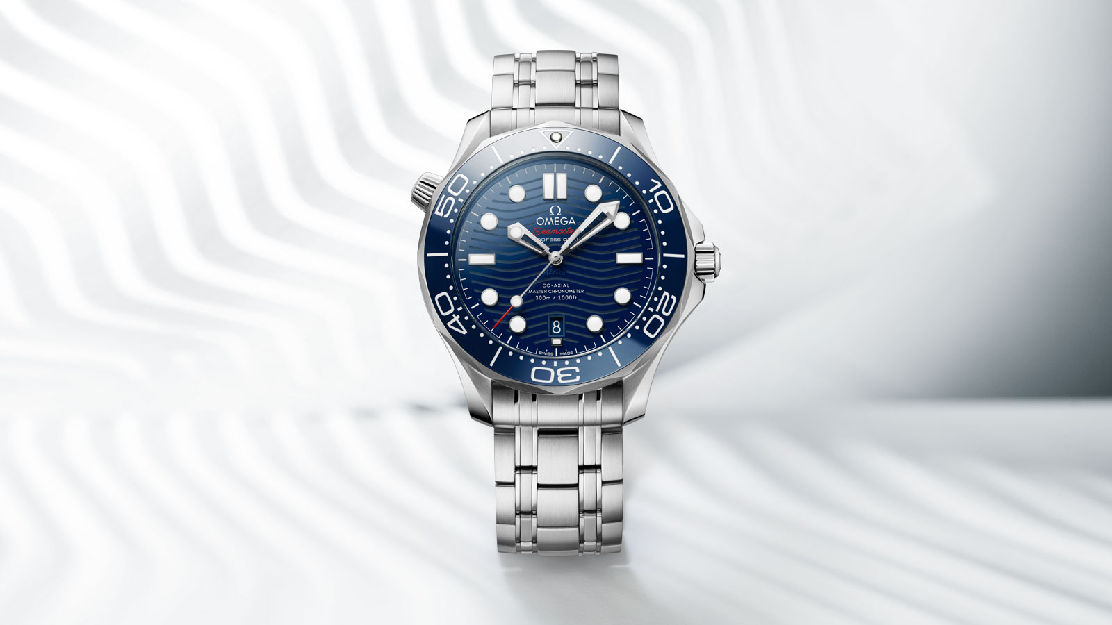 Front view of the Divers 300M watch in stainless steel with a dark blue dial and bezel