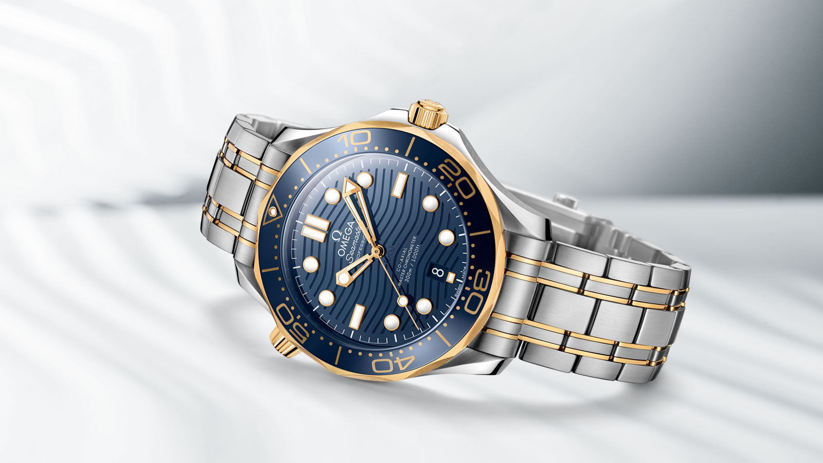 Seamaster Diver 300m watch in yellow gold and steel with its blue dial and bezel