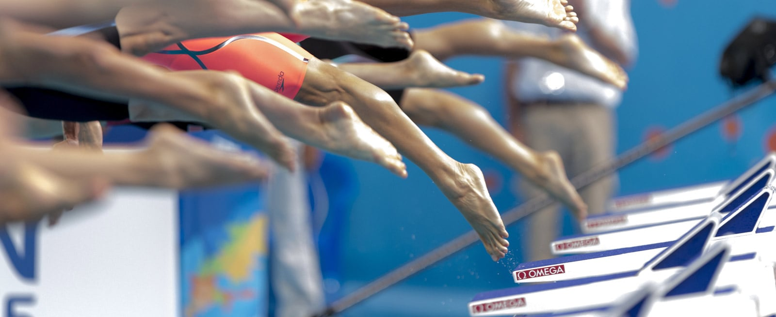 Photography of the feet of plunging swimmers