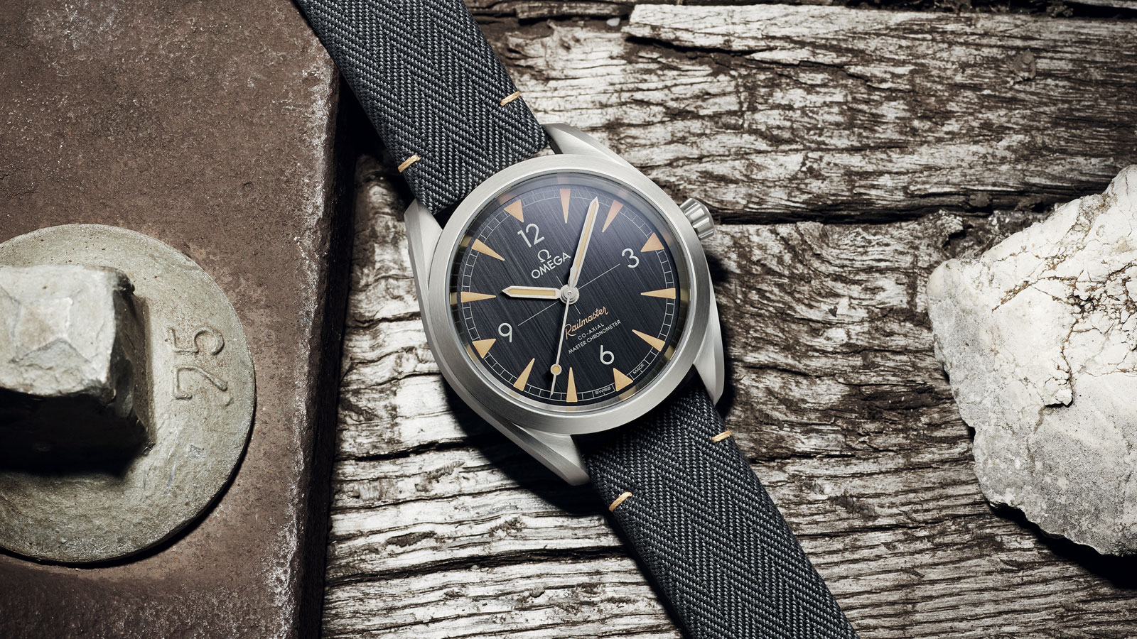 The Railmaster Omega Co-Axial Master Chronometer of the Seamaster Collection, presented on a wooden support