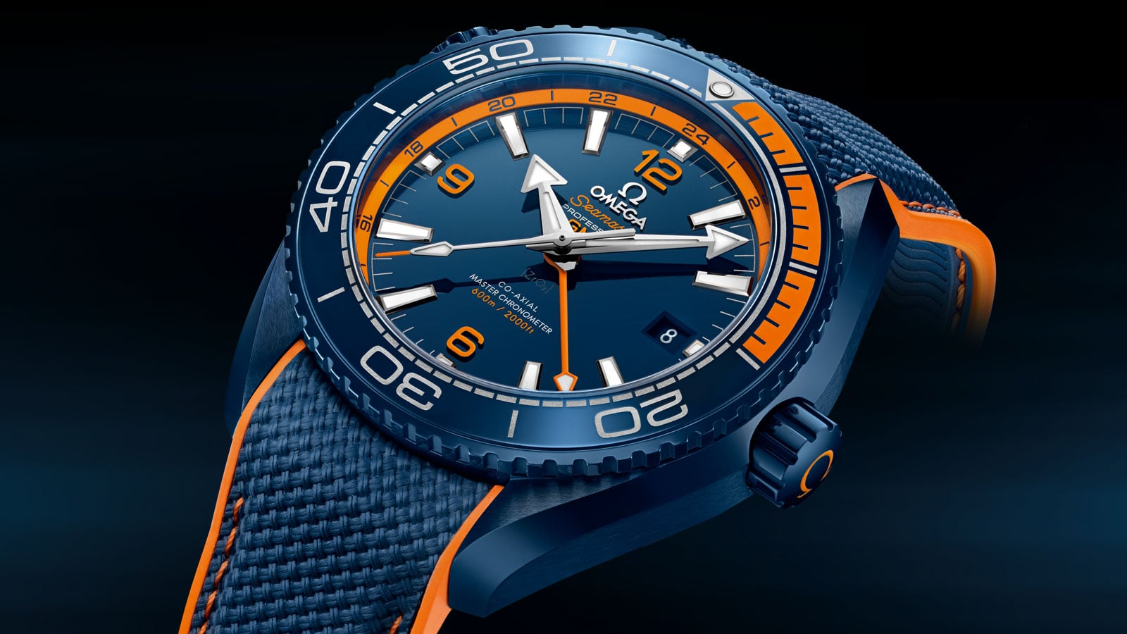 Close-up shot of the Diver 600M Big Blue dial. The hands and indexes are coated with Super-LumiNova.