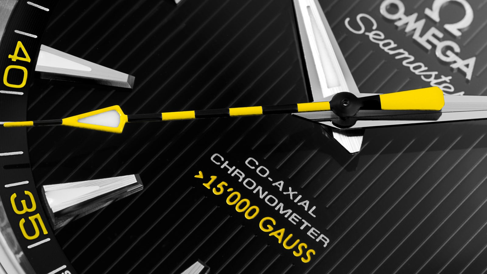 Closeup of the yellow and black striped seconds hands of the 15,000 gauss watch