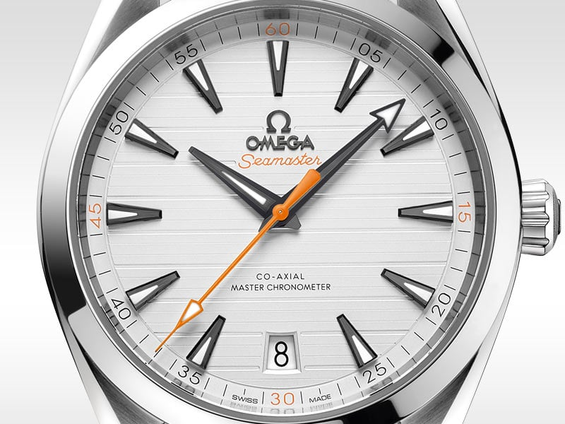 Close-up shot of the Seamaster Gents' Collection watch with silver back, white dial and orange second hand