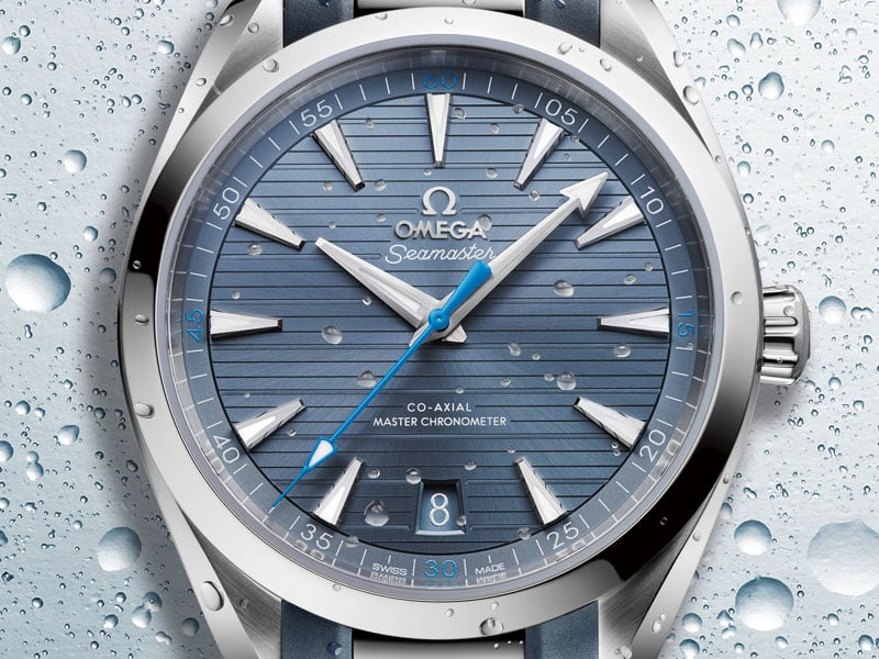 "The Seamaster Aqua Terra 150M Gents' Collection with its stainless steel case, the ""teak"" blue dial, and blue seconds hand."