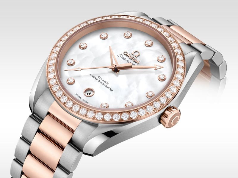 The Aqua Terra Ladies is encircled by diamond, its case and band is a mix between stainless steel and Sedna gold, the dial is made of white pearl