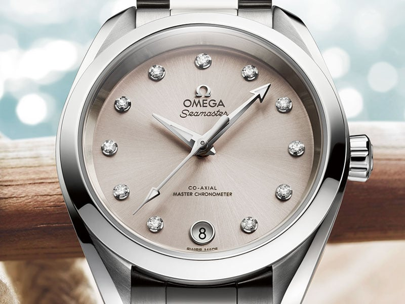 The Seamaster Aqua Terra 150M Ladies' Collection with its stainless steel case, the light grey dial and 11 diamonds indexing the time