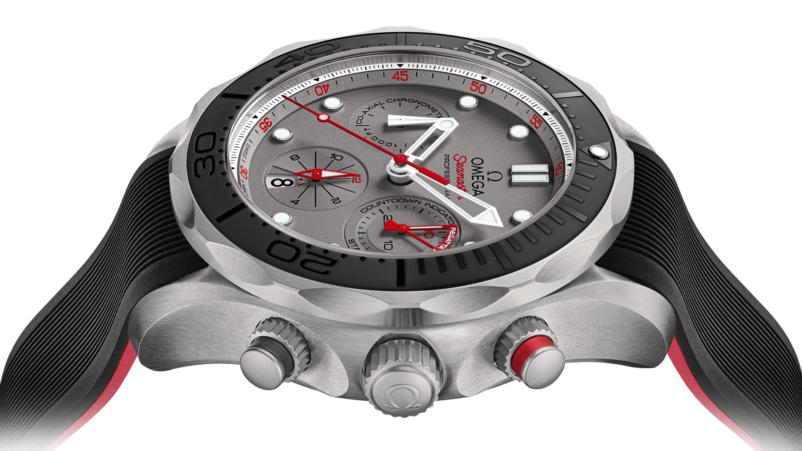 Close-up view of the right side of the Seamaster ETNZ watch and its two pushers. The red one, situated at 2 o'clock controls the chronograph. The black one is situated at 4 o'clock.