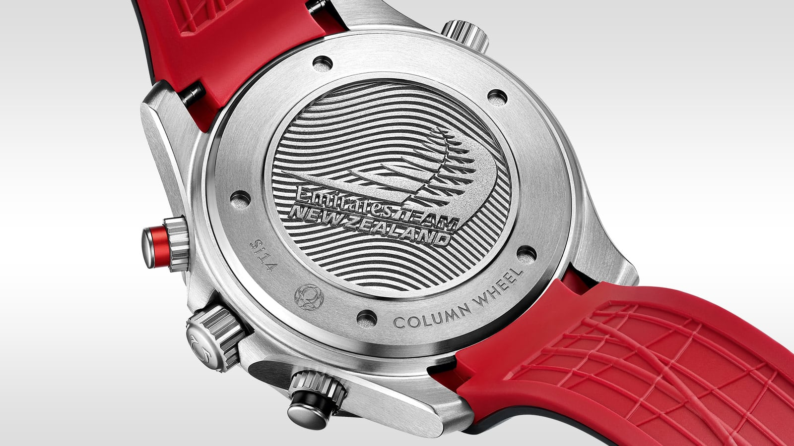 Back view of the ETNZ watch, the backside of the strap is red with a pattern that ensures that water and air can pass freely underneath, allowing the skin to breathe. The back of the watch is engraved with the ETNZ logo.