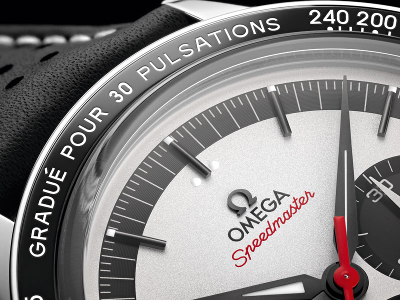 Close-up view of the upper part of the OMEGA SPEEDMASTER C K 2998 LIMITED EDITION white dial circled with a black bezel
