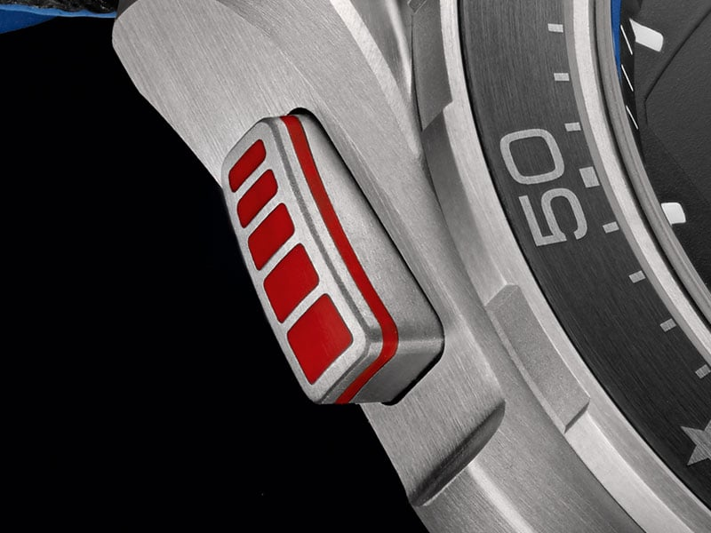 Closeup of the red and titanium pusher on the side of the X-33 Regatta watch