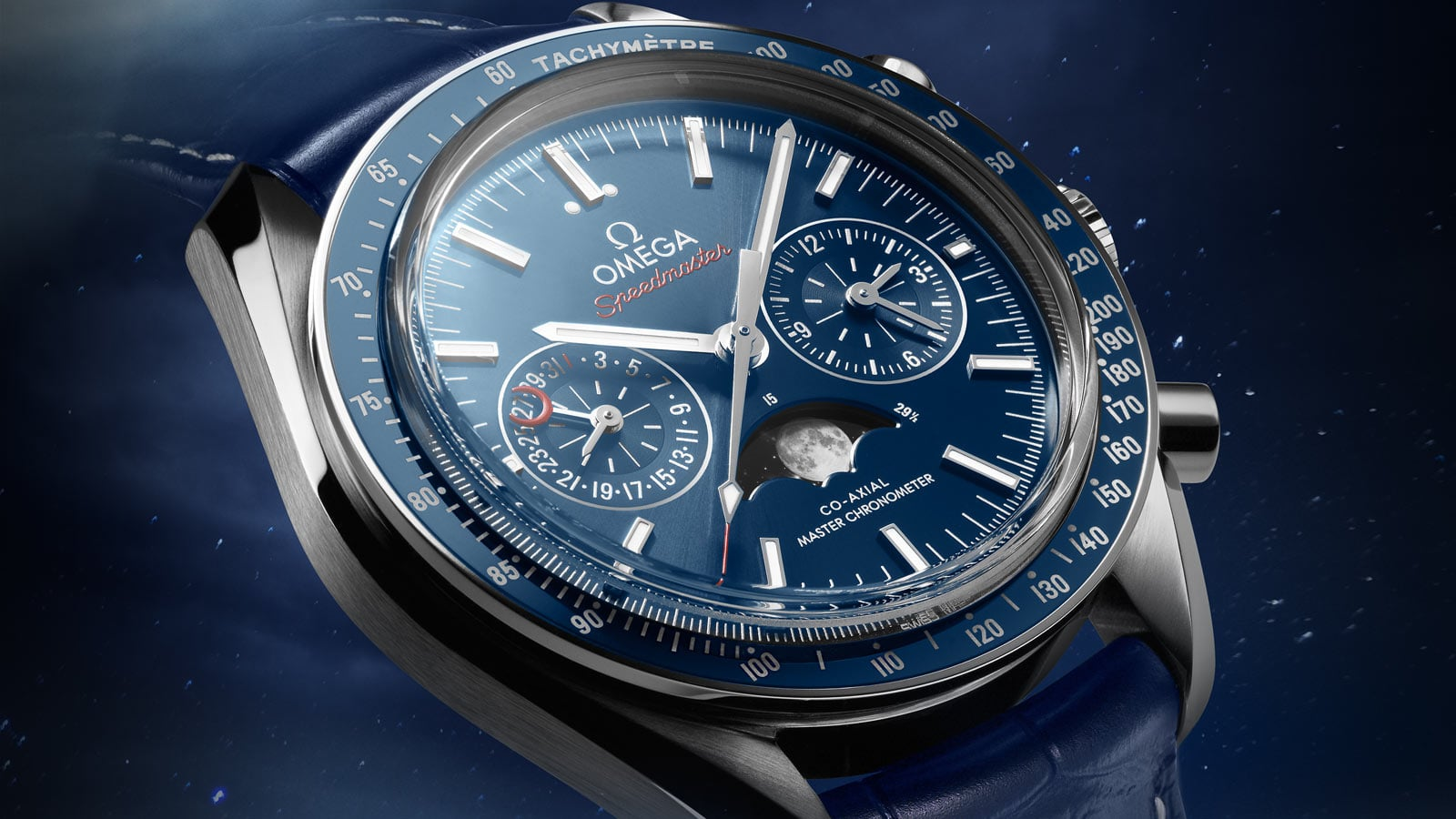 Close-up view of the Omega MOONWATCH MOONPHASE steel case on blue bracelet
