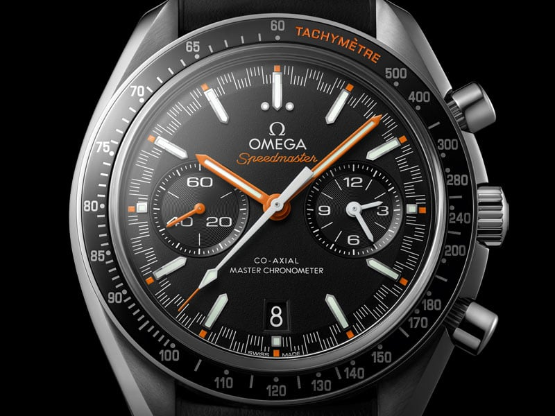Front view of the Omega SPEEDMASTER RACING MASTER CHRONOMETER 44.25 millimeters with steel case a black dial and orange minute and hour hands