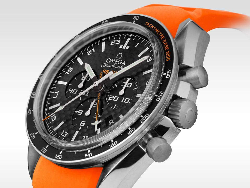 Omega SPEEDMASTER HB-SIA GMT CHRONOGRAPH with an orange rubber strap and a black carbon fiber dial
