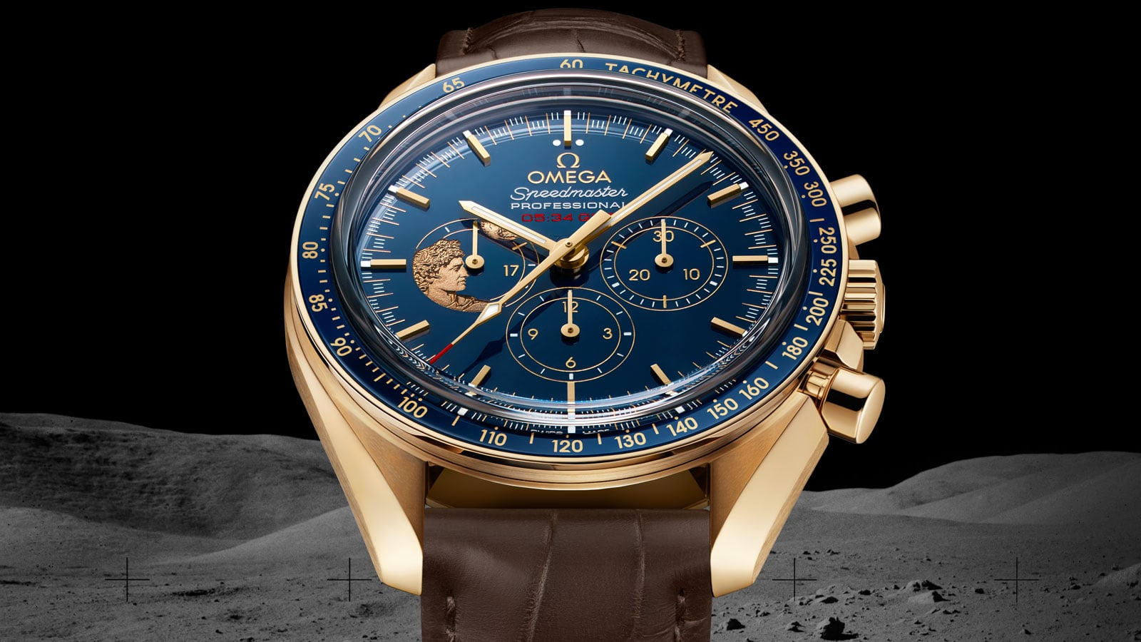 Close-up view of the OMEGA SPEEDMASTER APOLLO 17 45TH ANNIVERSARY LIMITED EDITION yellow gold model with blue ceramic dial a brown leather strap and 18K gold case and small elements