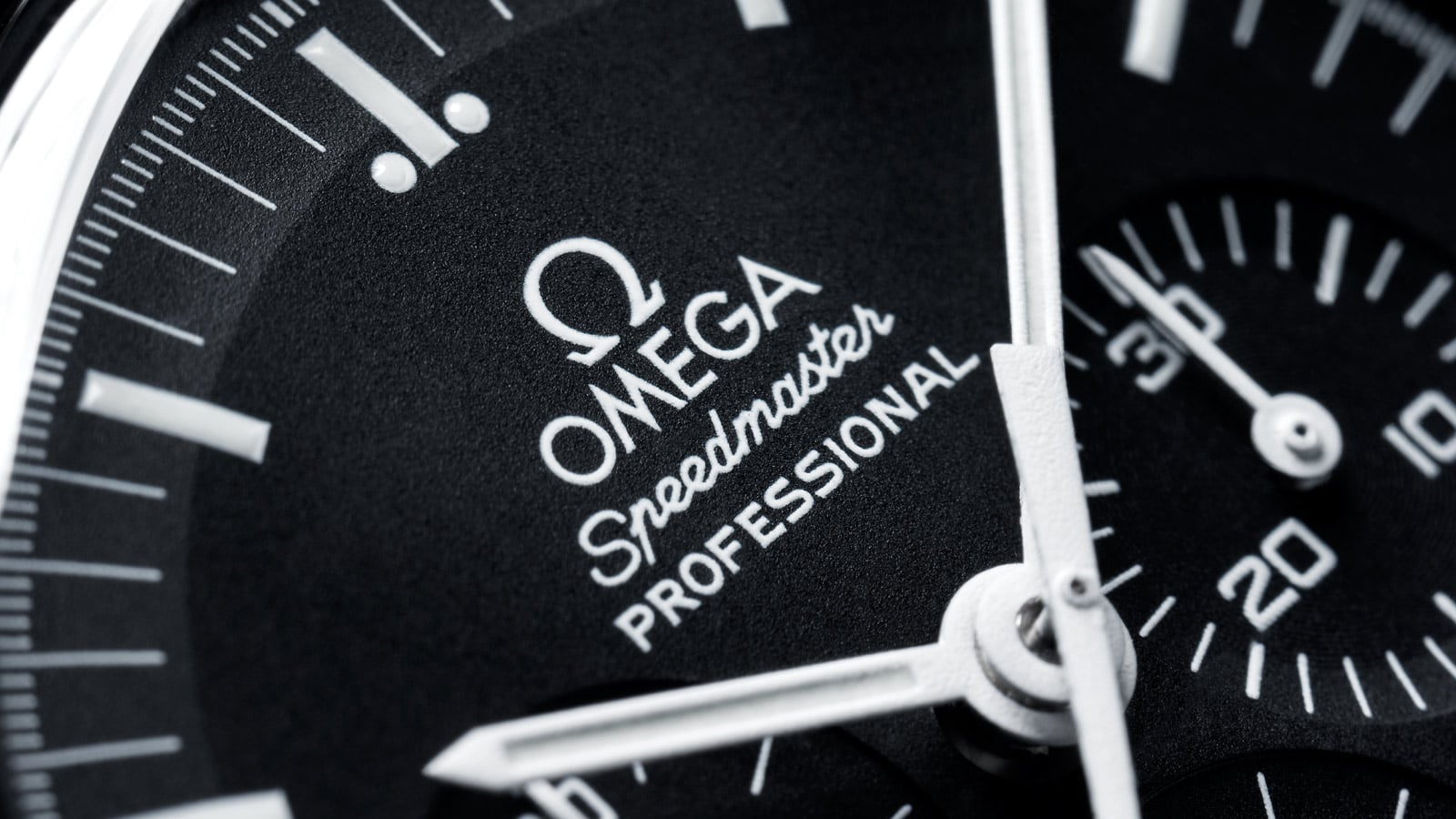 Close-up view of the Omega SPEEDMASTER PROFESSIONAL MOONWATCH white hour and minute hands on a black dial